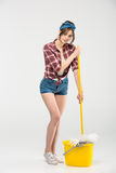 Young woman with mop Royalty Free Stock Image
