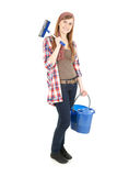 Young woman with mop and blue bucket Royalty Free Stock Images