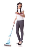 Young woman with mop and book. Stock Photo