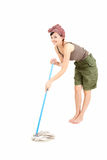 Young woman with mop cleaning floor, full length Royalty Free Stock Photo