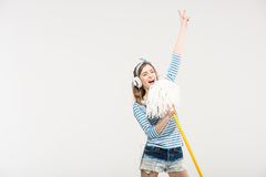 Young woman with mop stock photography
