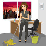 Young woman mopping floor with bucket and mop in office Stock Photography
