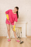 Young Woman Mopping Floor. At Home Stock Photography