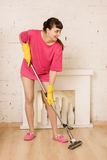 Young Woman Mopping Floor. At Home Royalty Free Stock Images
