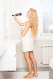 Young woman in the morning at bathroom. Woman in the morning at bathroom. Funny female sing song in comb Stock Images
