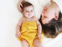 Young woman in the morning with small girl Royalty Free Stock Photo