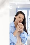 Young woman with morning tea Stock Photo