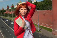 Young woman by Moscow Kremlin Royalty Free Stock Photos