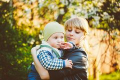 Young Woman Mother Hugging Her Baby Son Royalty Free Stock Images