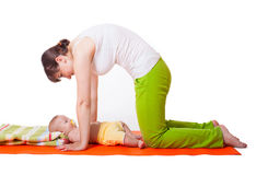 Young woman mother practicing yoga with baby Stock Photo