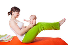 Young woman mother practicing yoga with baby Stock Image