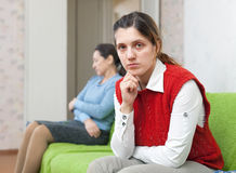 Young woman and mother after quarrel Stock Images