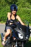 Young woman on motorbike Stock Photos