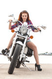 young woman on a motorcycle Stock Images