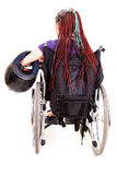 Young woman with motorcycle helmet on wheelchair Royalty Free Stock Photos