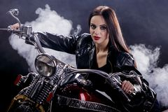 Young woman on the motorcycle Royalty Free Stock Image