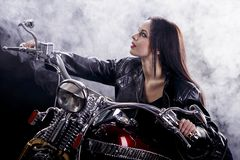 Young woman on the motorcycle Royalty Free Stock Images