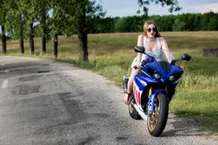 Young woman with a motorcycle speed Royalty Free Stock Photo