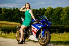 Young woman with a motorcycle speed Stock Photo