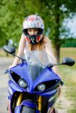 Young woman with a motorcycle speed Stock Images