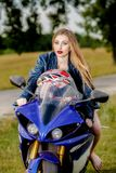 Young woman with a motorcycle speed Royalty Free Stock Photography