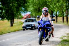 Young woman with a motorcycle speed Stock Photography