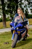 Young woman with a motorcycle speed Royalty Free Stock Images