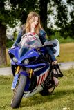 Young woman with a motorcycle speed Stock Photos
