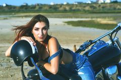Young woman on a motorcycle on a summer day stock photo