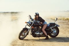 Young woman on a motorcycle on a summer day stock photos