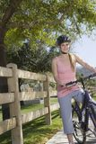 Young Woman With Mountain Bike Stock Image