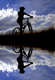 Young Woman Mountain Biking Royalty Free Stock Photos