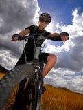 Young Woman Mountain Biking Royalty Free Stock Photo