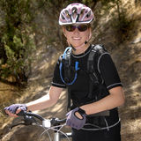 Young Woman Mountain Biking Royalty Free Stock Image