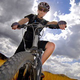 Young Woman Mountain Biking Stock Images