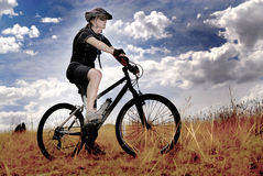 Young Woman Mountain Biking Royalty Free Stock Photo