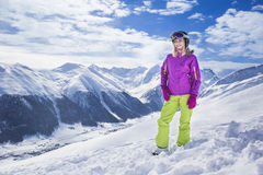 Young woman on a mountain ski resort Royalty Free Stock Photo