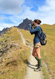 Young woman on mountain trail Royalty Free Stock Photography