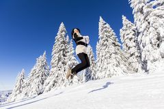 Young woman on the mountain in winter Stock Image