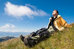 Young woman in mountains - relax scene Royalty Free Stock Image