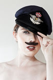 Young woman with moustache wearing cap Royalty Free Stock Image