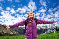 Young woman in the moutains. Young happy woman with outstretched arms hiking in the mountais Royalty Free Stock Photo