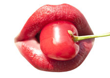 Young woman mouth with red cherry closeup Stock Photography