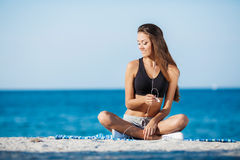 The young woman moves training on a beach. Stock Images