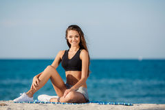 The young woman moves training on a beach. Stock Image