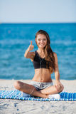 The young woman moves training on a beach. Stock Photography