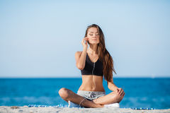 The young woman moves training on a beach. Royalty Free Stock Photography