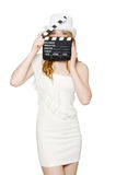 Young woman with movie board Stock Photo