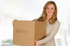 Young woman moving in Stock Photos