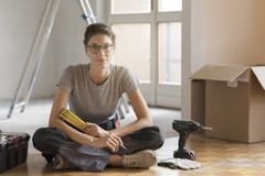 Young woman moving in her new house and doing a home makeover stock image
